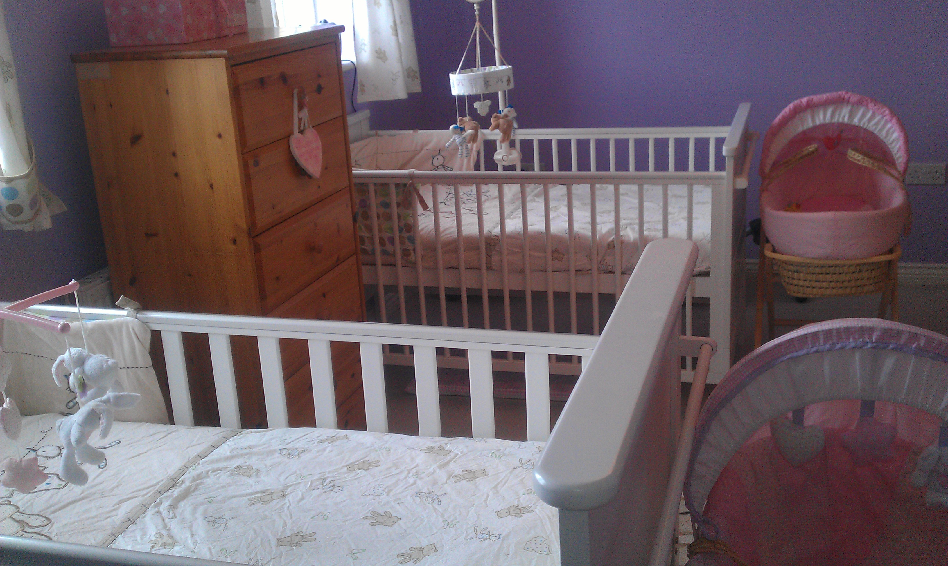 This was my twins nursery, just before they were born. This photo is part of my post on baby sleep tips.