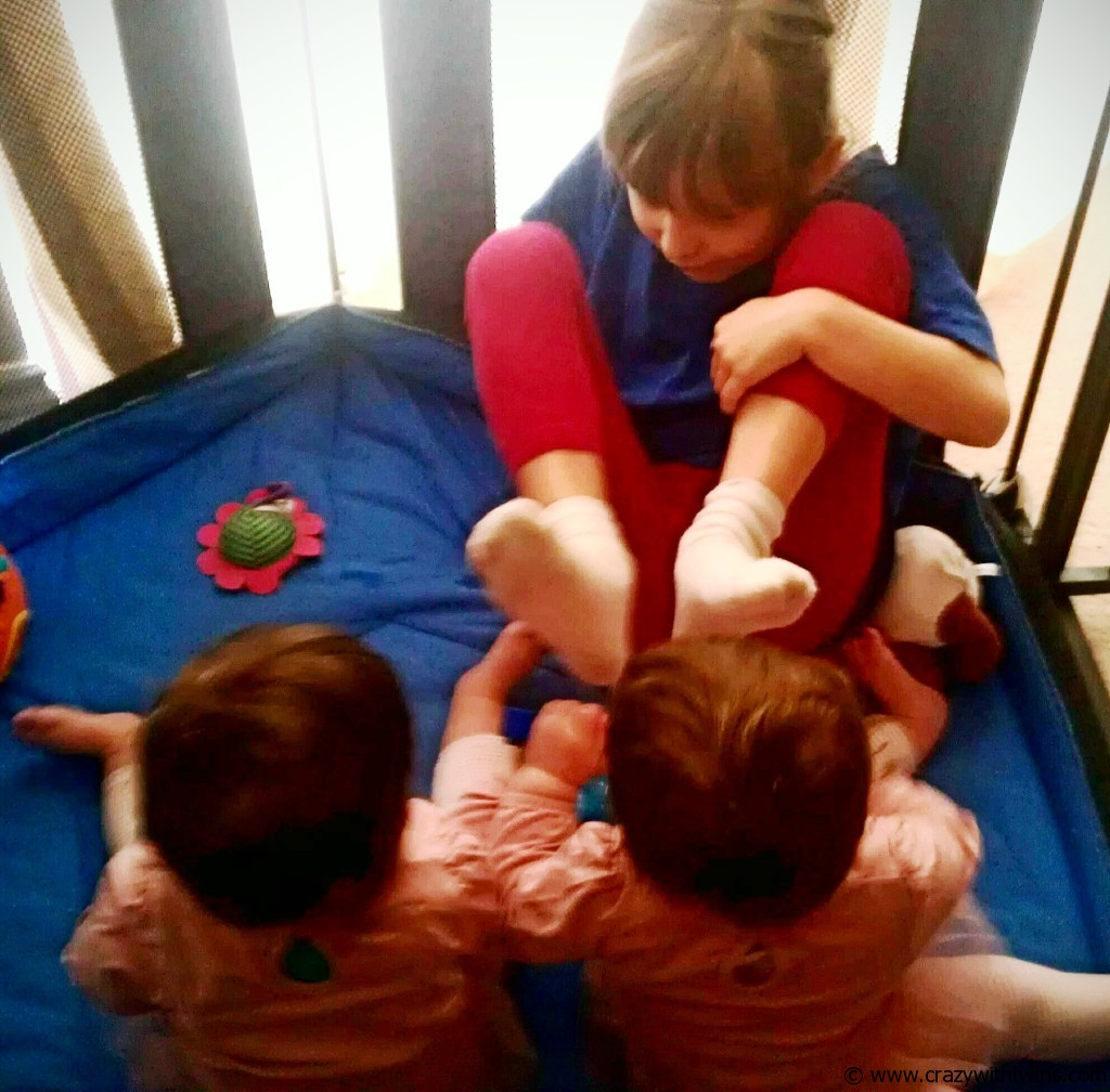 Playing with (pinching, hitting & biting) our big sisters feet!