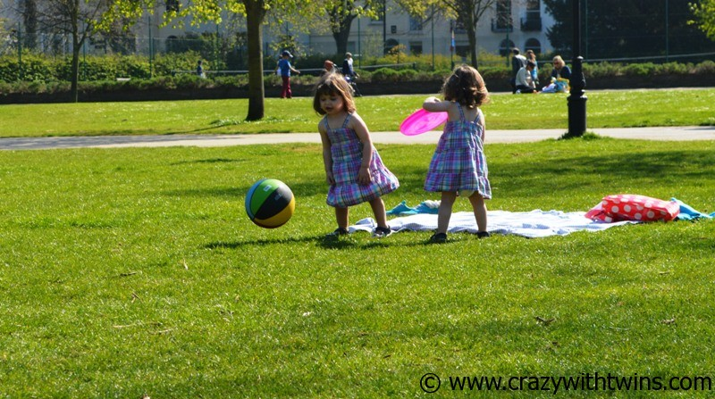 1 year old twins playing in the park