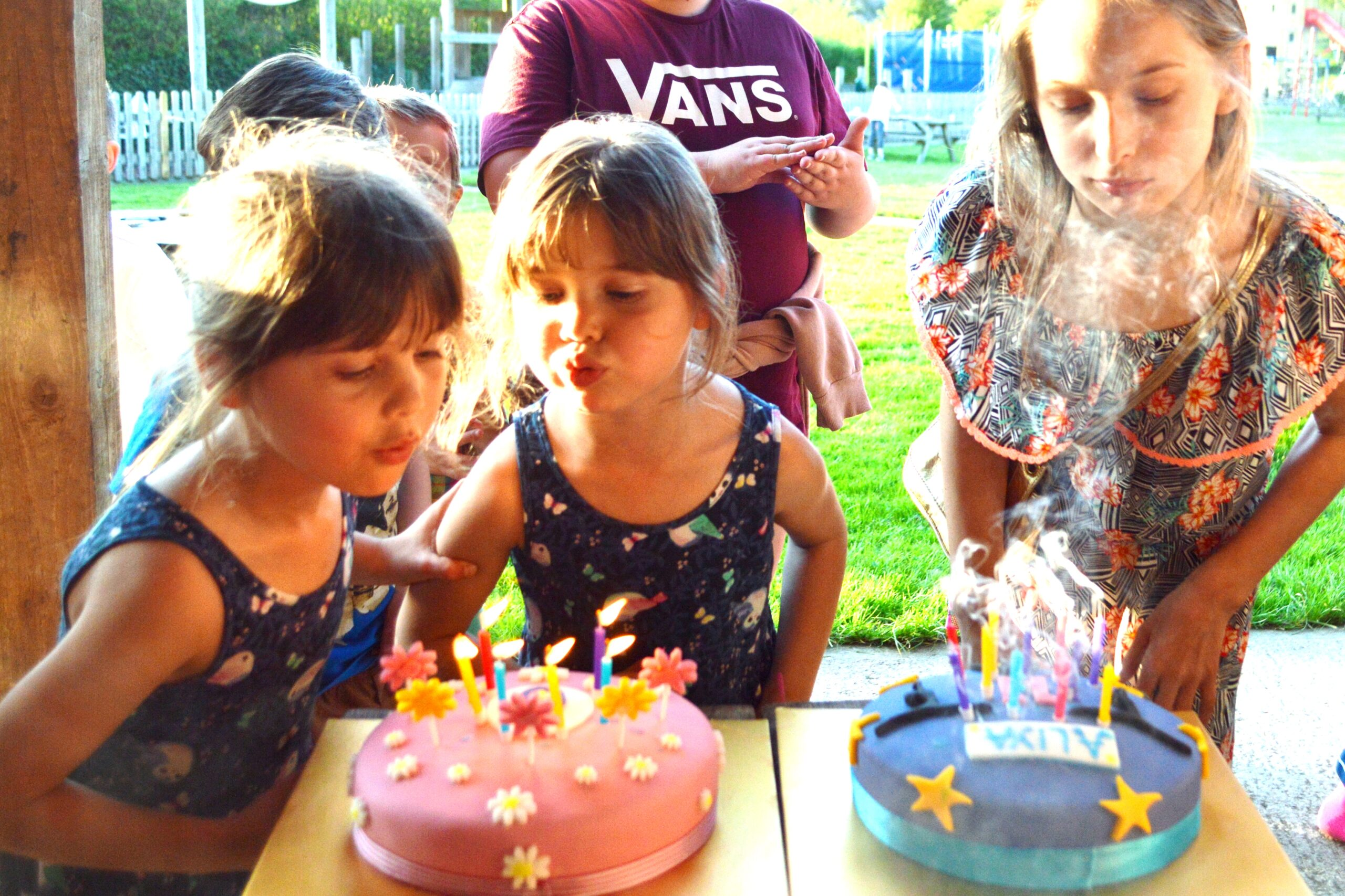 blowing out the candles, triple birthday party, twins birthday