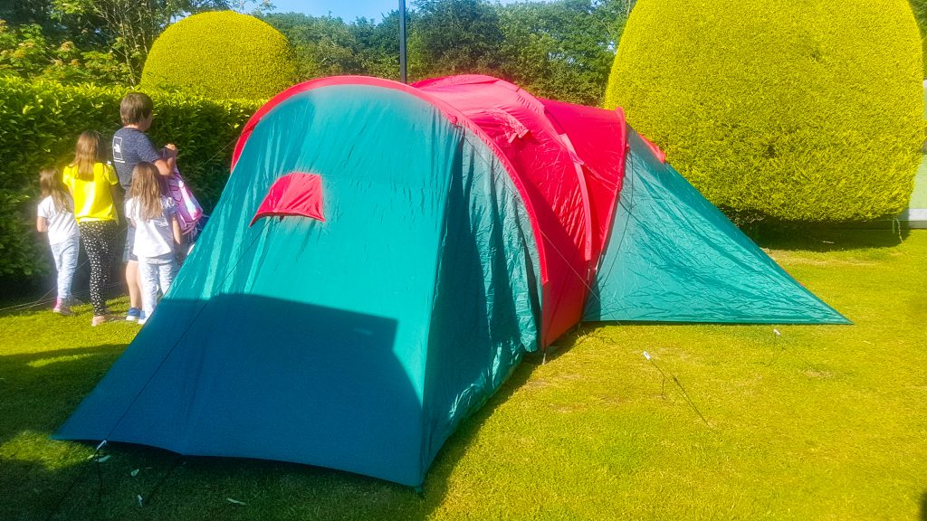 spontaneous camping trip, pod tent, family camping trip, green and red pod tent, 9 man tent, tent pitched at Merley Court Holiday Park