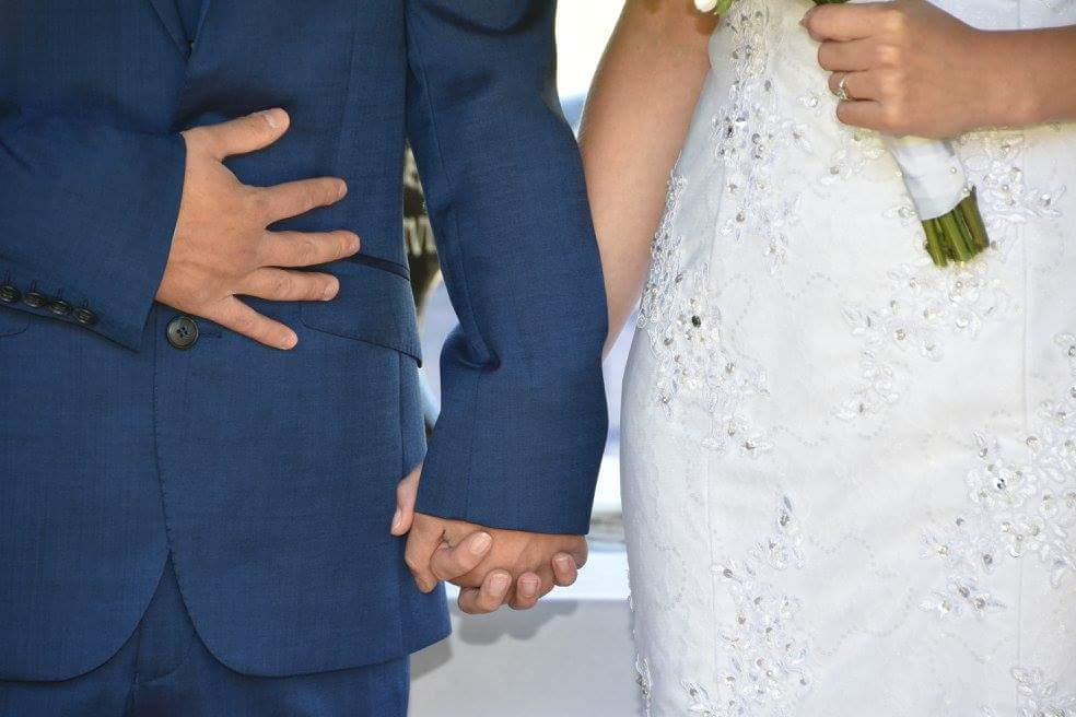 Wedding day, holding hands, bride and groom holind hands, First wedding anniversary memories