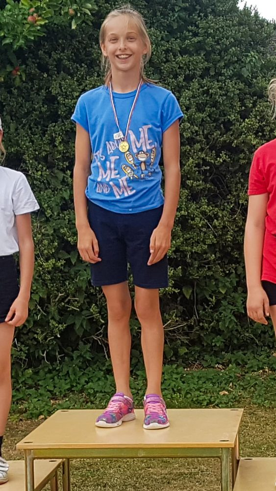 1st place podium position, sports day, standing in first place