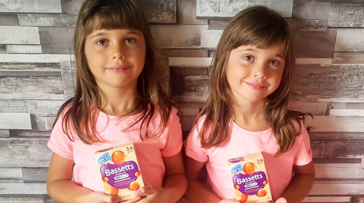 6 year old twins holding BassettsOmega-3 + Multivitamins for 3-6 year olds