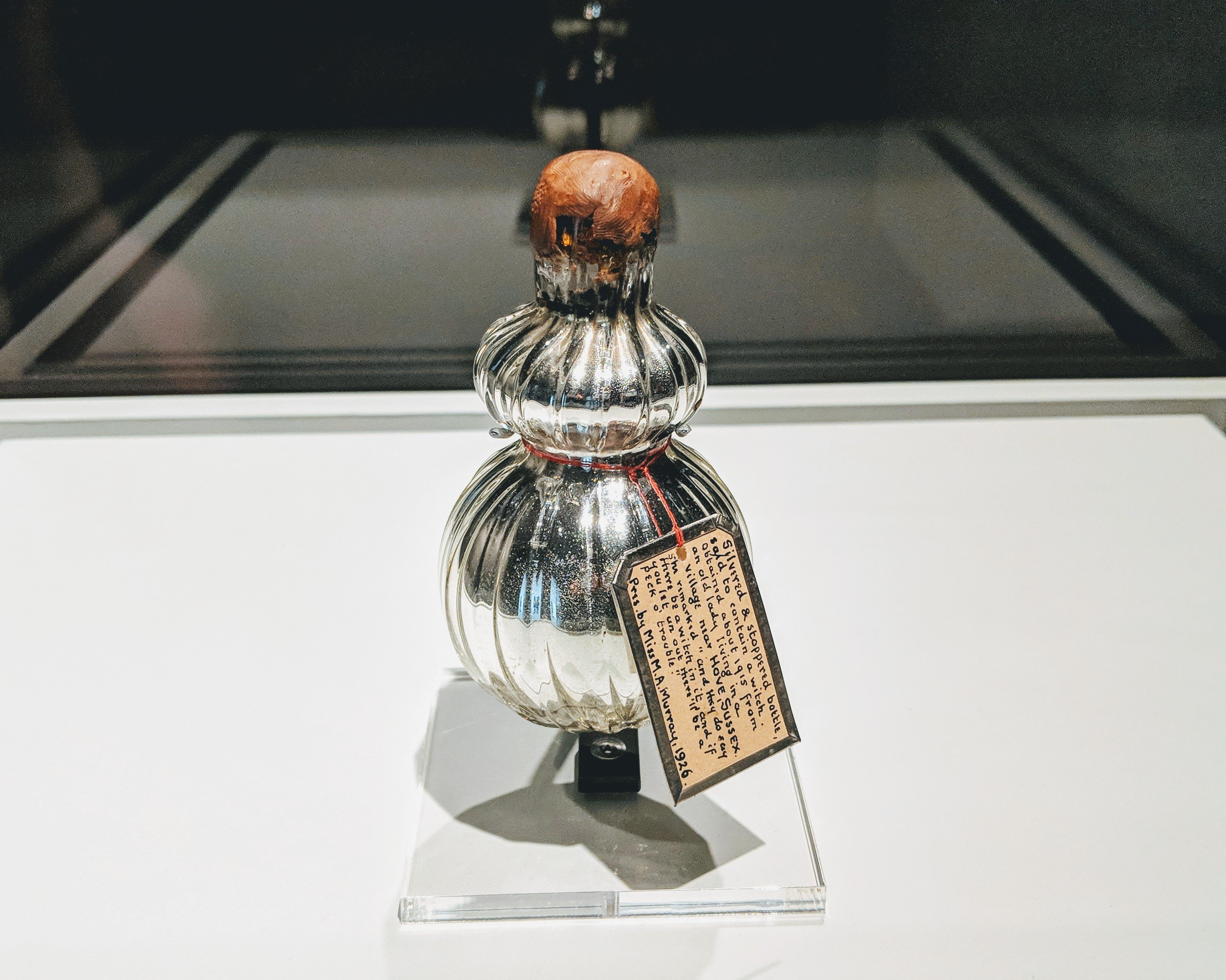 An unopened silver bottle, sealed with wax, believed to contain a witch, on display at the Spellbound exhibition at the Ashmolean in Oxford, UK.