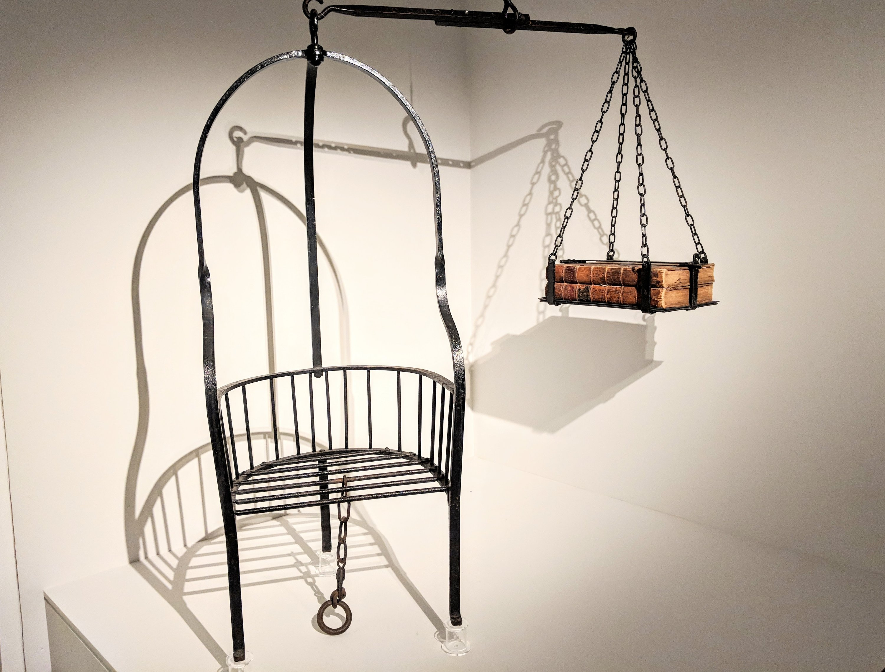 Witch weighing scales on exhibition at the Ashmolean in Oxford, UK.
