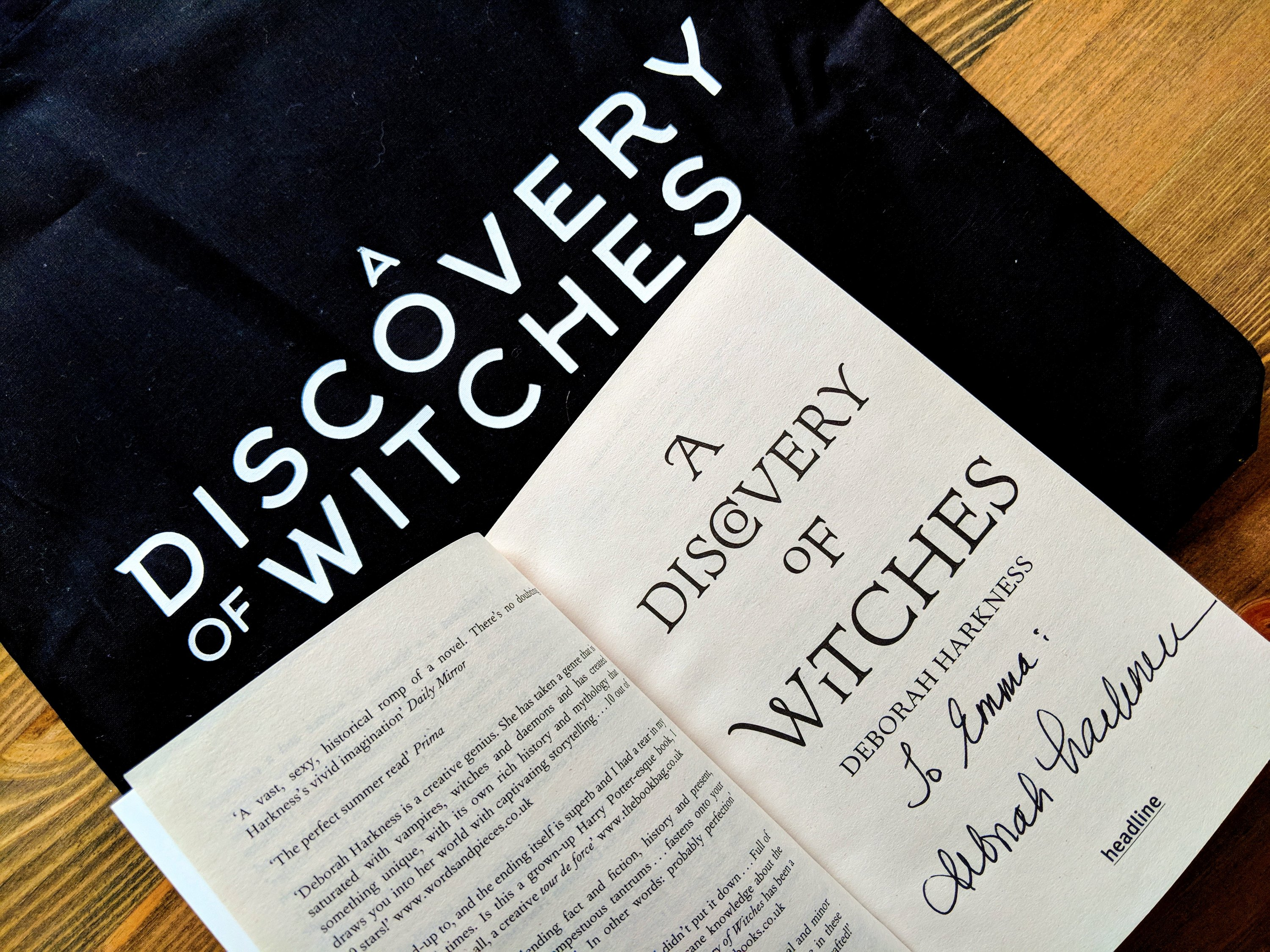 A Discovery of Witches book signed by Deborah Harkness and A Discovery of Witches black tote bag
