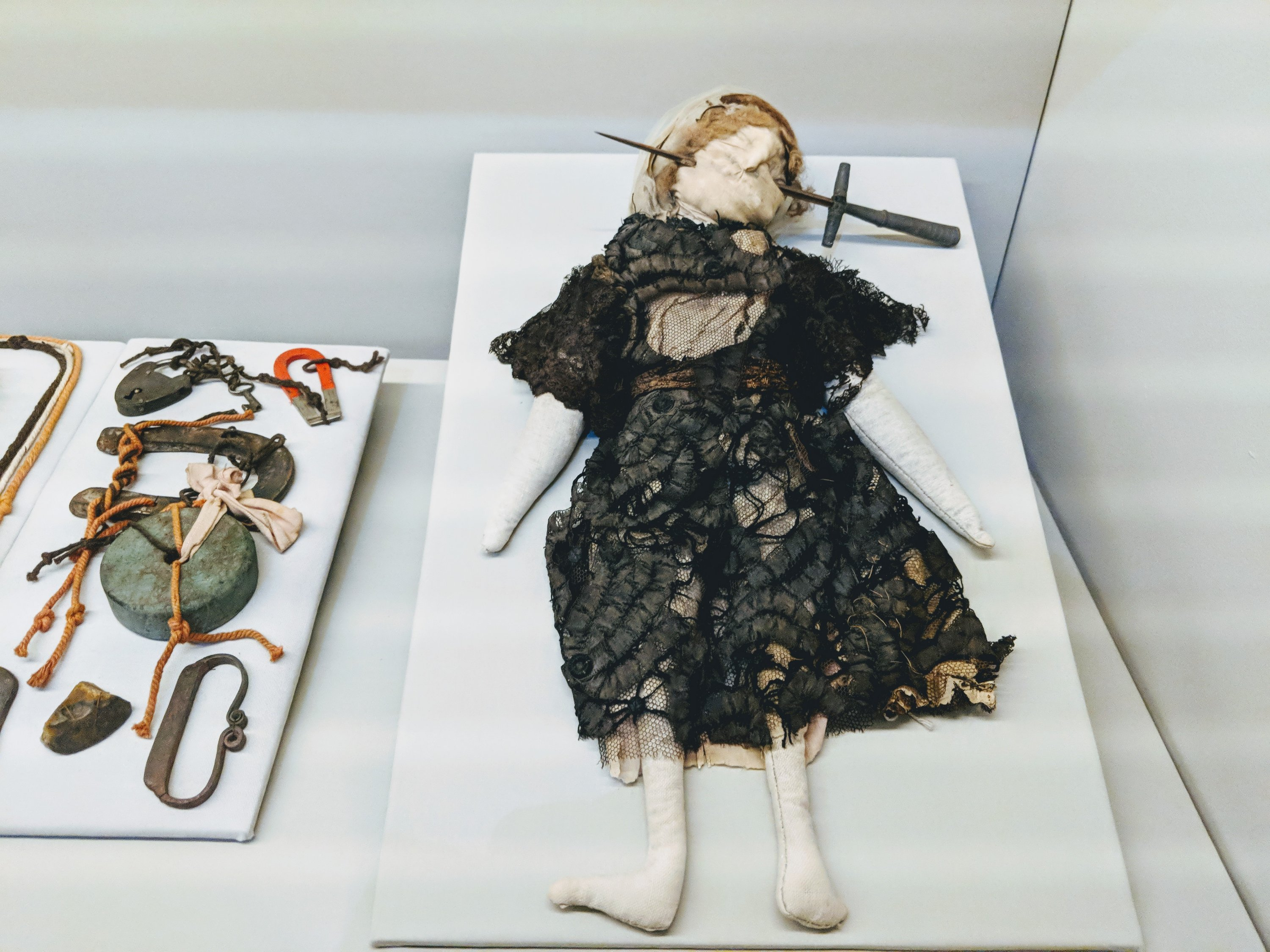 Voodoo doll and other witchcraft objects from the Spellbound Exhibition at the Ashmolean in Oxford, UK.