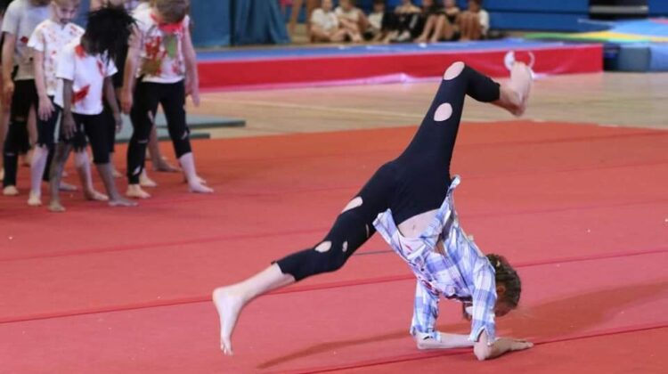 My 11 year old completing a gymnastics move which is part of a display she was doing to Michael Jacksons Thriller. This photo accompanies a post about her gymnastic dreams.
