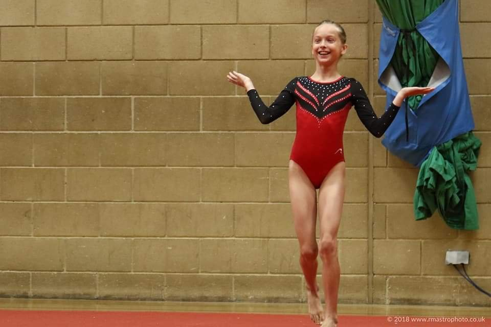 My 11 year old competing at a British acro gymnastics competition.
