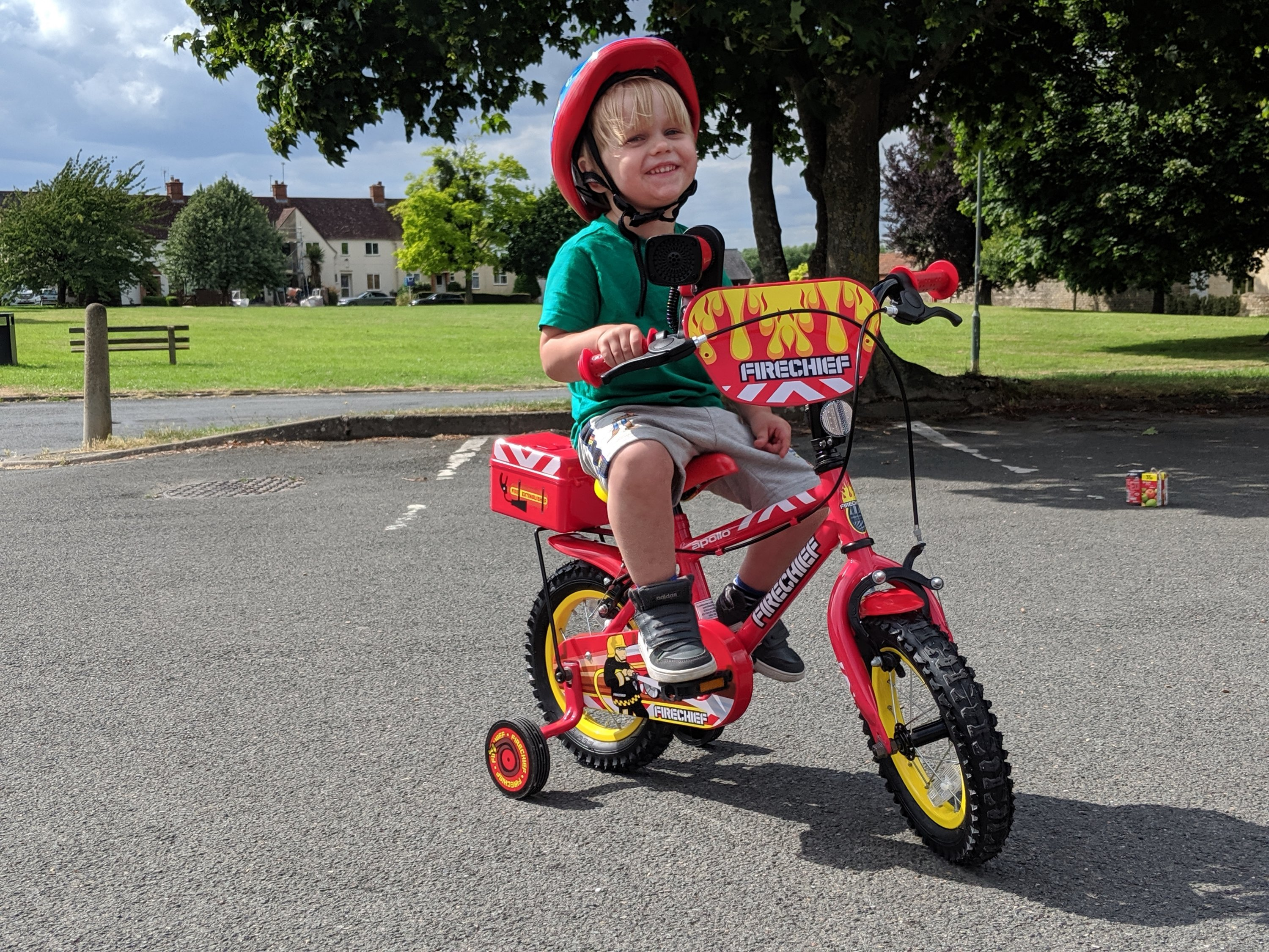 toddler riding a bike