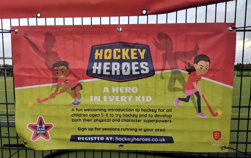 Banner attached to fence advertising Hockey Heroes
