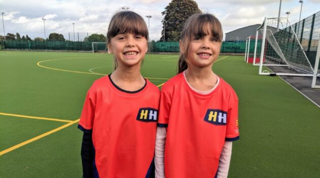 7 year old Twins in their orange Hockey Heroes tshirts