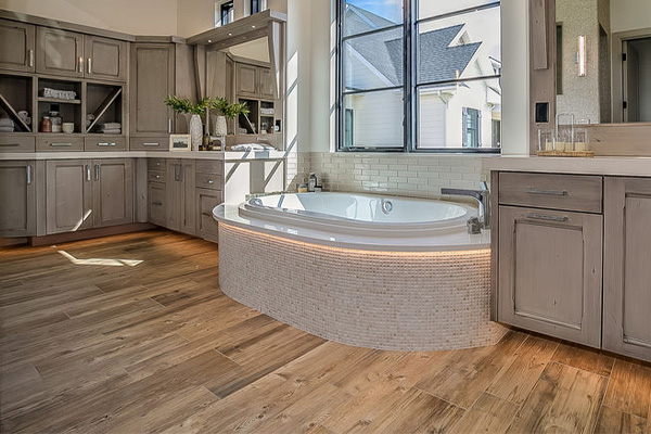 wood effect luxury vinyl flooring in a large bathroom