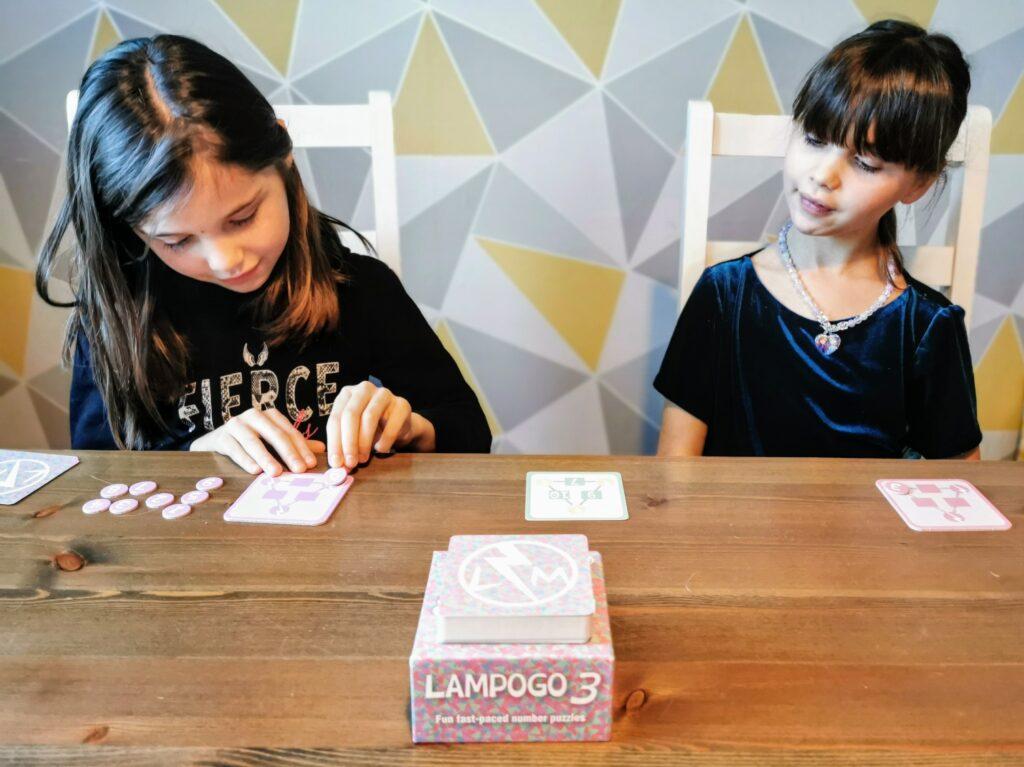 Twins playing Lampogo 3 maths game